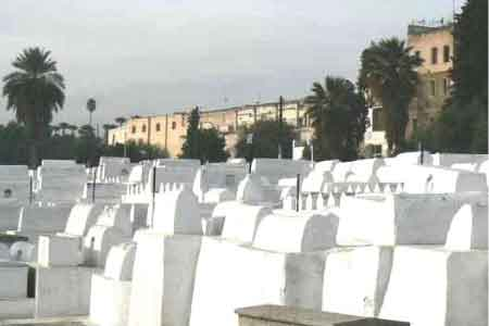 image of white washed tombs