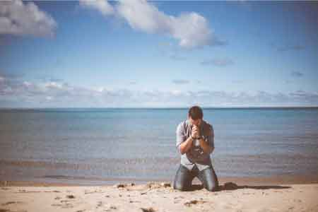 image of a man on his knees praying