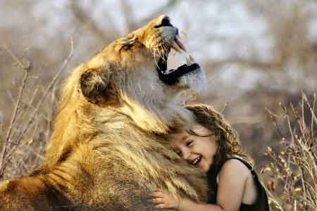 image of little girl with a lion
