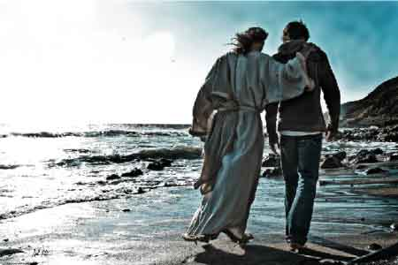 image of Jesus walking on the beach with a young man