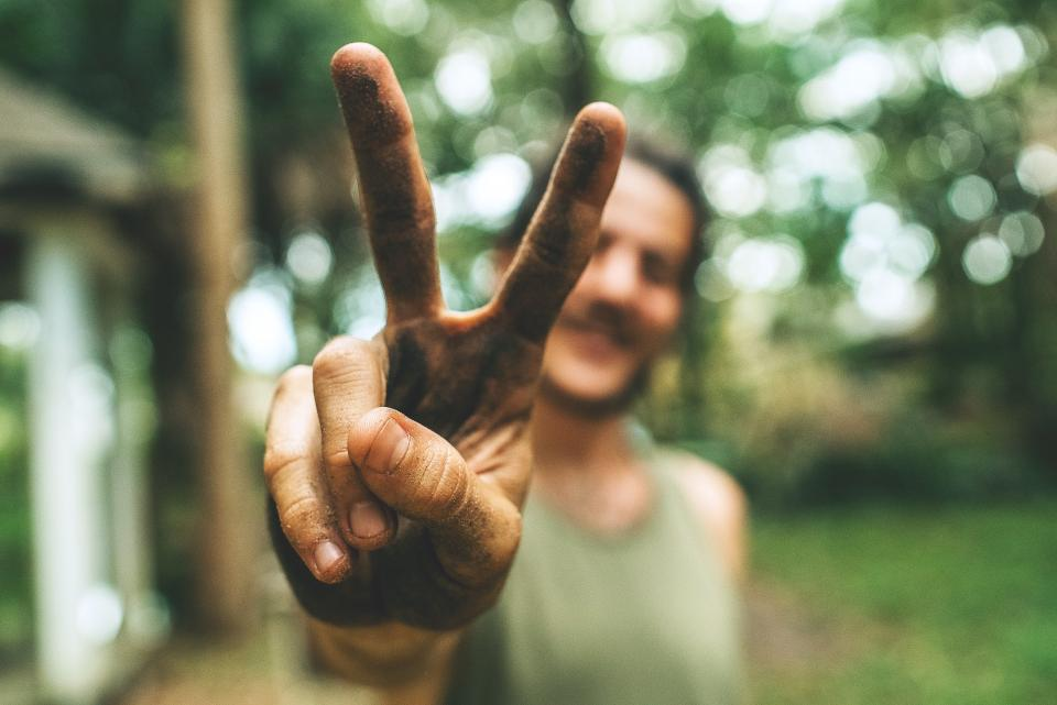 Image of a man making the peace sign